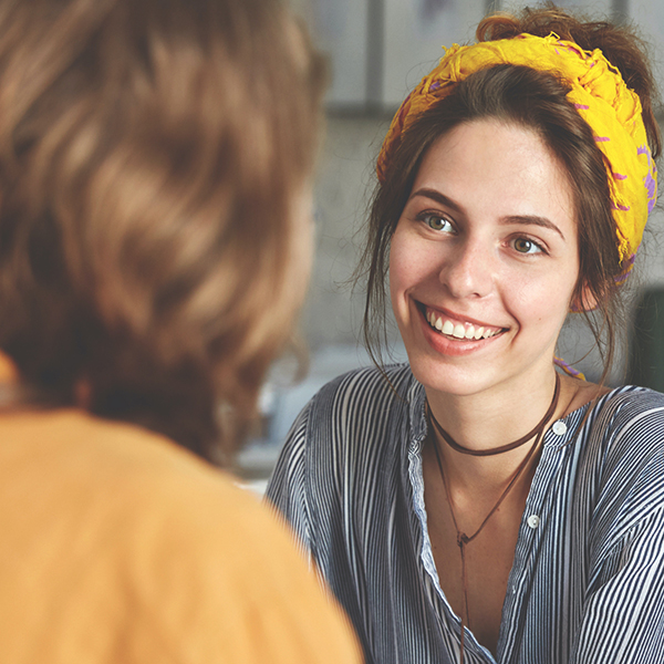 Female doctor smiling at patient during consultation